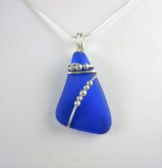Cobalt+blue+sea+glass+necklace+on+sterling+wire+wrap,+Monterey+Bay