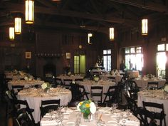 Mills College Student Union. Beige linens. Mahogany wood folding chairs.