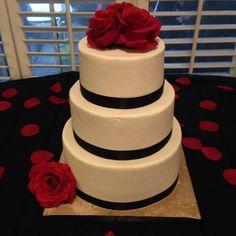 Black, red, and white wedding cake