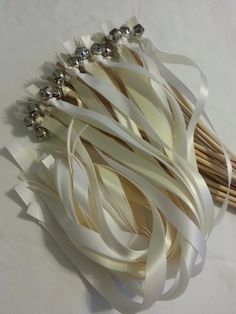 Amazon.com: 50 Wedding Wand Bell Ribbon Streamers in Bridal White & White ~ Divinity Braid ~ Send Off Bells ~ Ribbon Wands ~ Bell Wands ~ Wedding Wands: Home & Kitchen