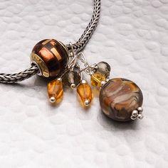 Etsy listing at https://www.etsy.com/listing/186258297/charm-bead-glass-lampwork-dangle-organic