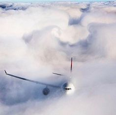 Unbelievable shot of a Delta Airbus A330 hiding in the clouds! ✈️☁️