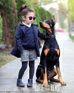 Too cool for school: Four-year-old Siena Prucha and her 80-pound dog Buddha make a stylish...