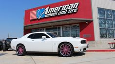 Lexani Wheels LSS-8 in Custom Pink and Black Center with Chrome Stainless Lip on a Dodge Challenger. 22x9 front with 265/35-22 and 22x10.5 rear with 295/30-22 tires. http://www.americanwheelandtire.com/houston-wheels/Lexani/