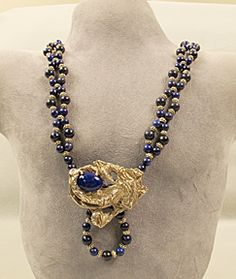 Lapis beads with free-form silver accent. Visit my website http://www.artisanbijoux.om