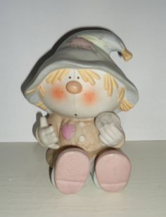 BUMPKINS SCARECROW Holding penny BANK by Fabrizio for by sweetpop, $14.95