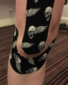 I don't normally post photos of body parts but my sprained knee has been given the 'rock tape' treatment by @massagebyelizabeth. She calls it her Lemmy tribute.  #skull #rocktape #wizardry #knee