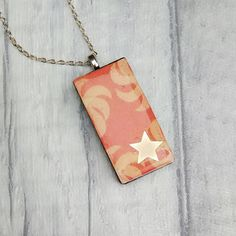 Orange star domino pendant upcycled domino necklace unique