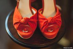 Orange wedding shoes with wedding rings