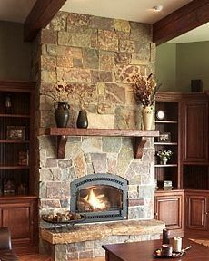 gas insert replacing wood stove, stone from top to bottom, barn wood mantle, and small ledge at bottom...