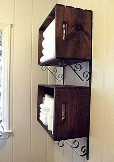 Use brackets to hang crates in the bathroom, great idea for extra storage!-