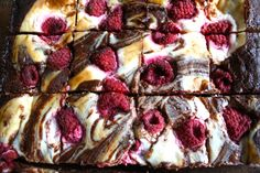 Ooey-gooey vegan brownie topped with vanilla cheesecake swirl and tangy  dots of raspberry.