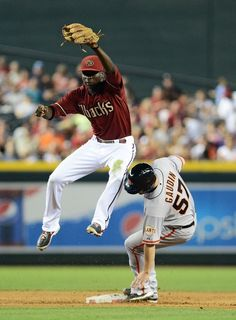 PHOENIX, AZ - JUNE 09: Pitcher Chad Gaudin #57 of the San Francisco Giants is tagged out at second by infielder Didi Gregorius #1 of the Arizona Diamondbacks in the sixth inning at Chase Field on June 9, 2013 in Phoenix, Arizona. (Photo by Jennifer Stewart/Getty Images)