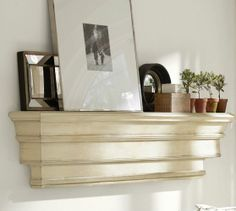 Decorative Ledge | Pottery Barn {Great way to fill the small space that is a ledge shelf}