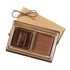 Choose between three budget conscious chocolate gifts with your choice of two milk and dark stock themed 3D pieces, a custom logo or both. Your choice of silver or gold gift box with matching stretch bow.