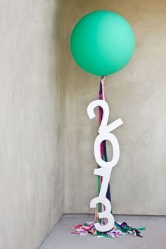 Vanessa we can do this with glitter letters clear balloons and metallic ribbons