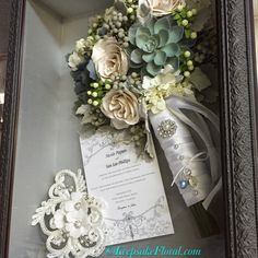 Beautiful preserved rose and succulent bouquet on a silver pulled silk background, displayed in a custom shadow box. Wedding Bouquets, Wedding Flowers, Wedding Day, Custom Shadow Box, Flower Preservation, Succulent Bouquet, Sustainable Wedding, Wedding Keepsakes, How To Preserve Flowers