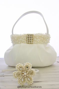 *** This listing is for the PURSE ONLY ***  ( If you would like to purchase the matching headband, here is the listing: https://www.etsy.com/listing/193268071/pearl-flower-arch-headband-pearl-flower )  OFF WHITE/ IVORY PEARL PURSE  - Unique Handcraft Purse with Bow Embellished with high quality Rhinestones & Pearls applied on a handbag.  - Purse dimension is 8W x 7H ( not counting with the handles)  - All items posted in my store are ready to be shipped, First Class Mail, unless you need a…