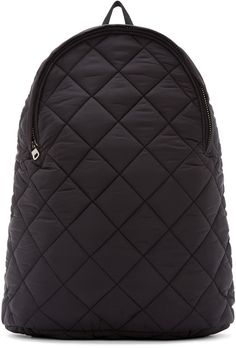 Nylon backpack in black. Diamond quilting throughout. Textile carry handle. Rounded zipper closure at front in silver-tone. Padded adjustable shoulder straps. Leather logo patch at back. Laptop compartment at interior. Textile lining. Tonal stitching.