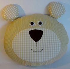 http://www.elo7.com.br/almofada-de-urso-bege/dp/228613  Almofada de urso estampa poá + xadrez, tecido 100% algodão, com enchimento de plumante. R$49,90