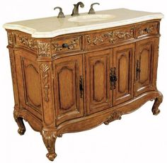 This impressive sink chest offers much to be desired. From its wealth of delicate carvings to its dusty wax finish and Ivory Cream marble top. www.mkhomedesign.com