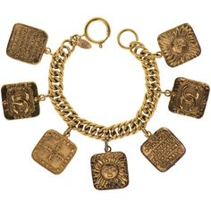 Pre-owned Chanel Vintage Gold Astrology Charm Bracelet (€1.140) ❤ liked on Polyvore featuring jewelry, bracelets, cross charm bracelet, gold charms, charm jewelry, cross bracelet charms and gold jewelry