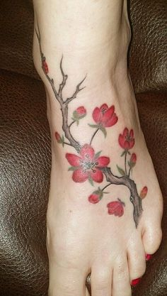 Blossoms with Ladybug ankle tattoo