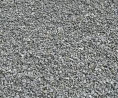 What to Put on the Ground in a Dog Run | Pea Gravel or crushed granite | Note: when I personally think about pea gravel I actually mean larger smoothed gravel, not the pea gravel you can buy at hardware stores. That stuff is a bit too small for large dogs and easily gets stuck between pads and some of the stone shards can be quite sharp.
