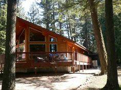 Lakefront property log cabin for sale outside of Spokane WA on Sacheen Lake. Gorgeous!