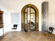 Grand entryway with gold doorframe
