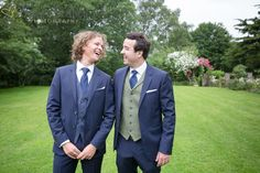 laughing groom and bestman at The Great Tythe Barn, Tetbury, Gloucestershire.