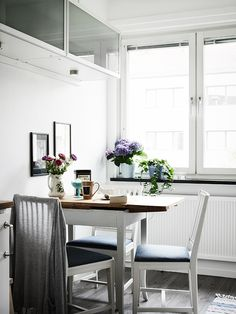 little kitchen table + white chairs.