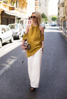 Beat the heat with this roundup of stylish work wear inspiration for summer | Lisa Rvd in marigold cold shoulder blouse and white wide-leg slacks