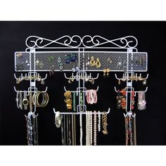 http://103rdavenue.com/organizing-jewelry-valet-white-14-5h-x-23-75w-x-2-375d/ The Organizing Jewelry Valet is the ultimate hanging jewelry organizer, ready to store hundreds of jewelry pieces, keeping them tangle-free and ready for easy access!  Made of coated wire, this over the door jewelry rack can be wall mounted or used over the door with the included hooks. Assembly level/degree of difficulty: Moderate.
