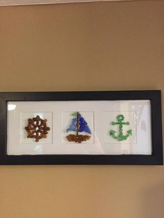 This is perfect for your favorite captain or as an addition to your nautical room. Made with seaglass found along the shore of Lake Erie. Rare cobalt blue makes up the sails. Wooden black frame measures 7x15.5 and has a white mat. Ivory and White Cardstock for background can be changed