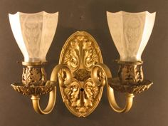 Heavy deep castback, acanthus leaf backplate with foliate bobechesand socket covers; shown with period 2 shades Circa date: 1910 Victorian Wall Sconces, Victorian Lighting, Antique Lighting, Home Design, Küchen Design, Victorian Homes, Victorian Era, Unique Lamps, Acanthus