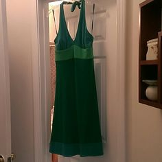Halter dress BCBGMaxazria Very pretty green BCBG MAXAZRIA halter dress.  Has green band and teal top and teal at bottom.  Never worn BCBGMaxAzria Dresses