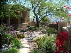 Stone walkway is set off nicely by landscape plantings. Photos courtesy of Casa Serena Landscape Designs LLC in Las Cruces, NM