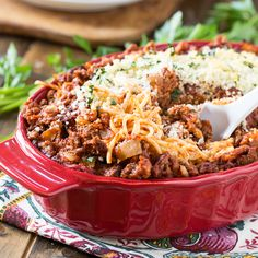 Baked Spaghetti from Spicy Southern Kitchen - oodles of noodles and a creamy filling combined with a meaty spaghetti sauce - I'm in drooling heaven over here!