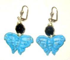 Earrings are designed and created by Mystic Angel Creations. Materials used: artisan grade wire, crystals and ceramic butterflies.