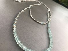 """Sterling & Fine Thai Silver and Apatite Necklace    Sterling & fine silver apatite gemstone necklace. Hand made double lobster clasp. 26"""" (1st drop) - 30"""" long drops & hook clasp."""