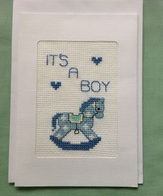 """New Baby Greeting Card – This lovely greeting card would be ideal for a new mother. Cross stitched on the front is a cute little Rocking Horse. It has an inner page; card message reads """"Congratulations on the arrival of your beautiful baby boy"""". https://www.hand-made.com.au/LindabearsHandmade"""