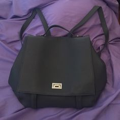 Gray Forever 21 backpack style purse NWOT I carried it maybe once. Has 3 inside pouches. Adjustable straps. Velcro and twistable latch to close. Sides can be buttoned or unbuttoned to make it larger or smaller. Forever 21 Bags Backpacks