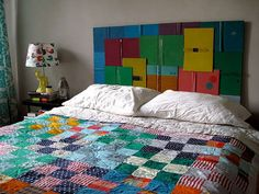 Well aside from the beautiful quilt on the bed, I love the book headboard.
