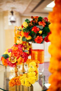 Tall centerpieces with hanging garlands Diwali Decorations, Flower Decorations, Table Decorations, Diwali Flowers, Mehendi Decor Ideas, Colorful Centerpieces, Big Fat Indian Wedding, Table Set Up, Happy Diwali