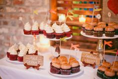 cupcake bars are still in and the proof is in the pudding with this yummy setup   Cupcakes by http://www.freshcupcakes.com/  Photography by shannonmichelephotography.com