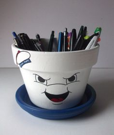 Stay Puft Marshmallow Man painted flower pots now available by GingerPots on Etsy!  [this would look so cool on the kitchen counter with utensils!]