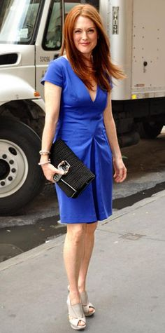 Look of the Day › June 30, 2010 WHAT SHE WORE In honor of The Kids Are All Right, Moore lunched at N.Y.C.'s Rouge Tomate in a vibrant blue Brian Reyes dress accessorized with peep-toe slingbacks and a snakeskin-trimmed clutch.