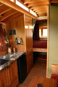 One side of the kitchen/dining area, with a view back to the bedroom.  #TinyHouseforUs