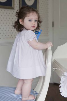 This little girl looks picture perfect in her Spring 2014 pink pintucked Feltman Brothers dress!